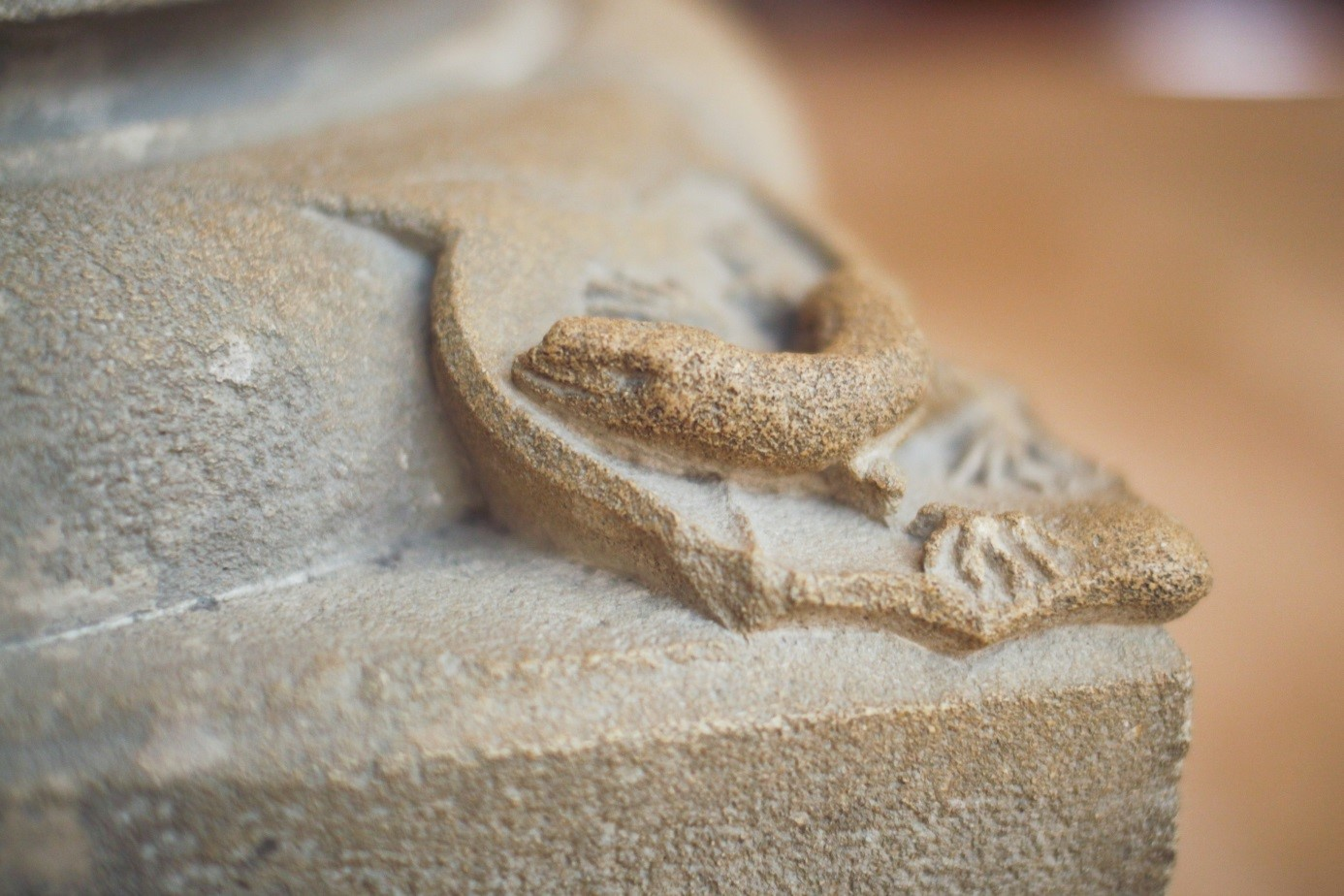 Romanesque lizard sculpture